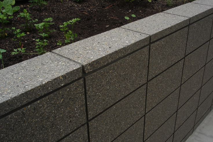 Honed Grey Coloured Masonry Retaining Wall Sealed In a Wet Look Sealer