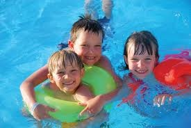 children enjoying in water