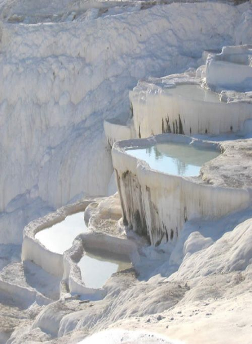 "✮ Pamukkale ~  meaning ""cotton castle"" in Turkish, is a natural site in Denizli Province in southwestern Turkey. The city contains hot springs and travertines, terraces of carbonate minerals left by the flowing water. It is located in Turkey's Inner Aegean region, in the River Menderes valley, which has a temperate climate for most of the year."