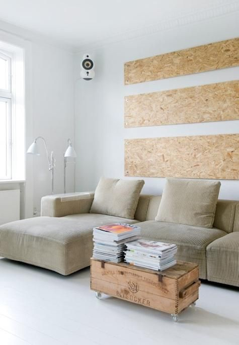 particle board as wall decor. over bed? I'd paint it or something but cheap way to get a big frame - or maybe cork board?