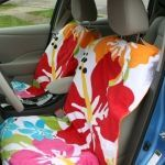 To make these seat covers, you only need to take one measurement, and that's around the fattest part of the headrest. You'll need this measurement to make sure you make a hole that will fit over the headrest later.  For the materials, you need a beach towel and a vinyl tablecloth