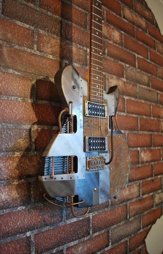 One of the cooler steampunk guitar mods I've seen.  Looks like a cheapo Washburn that's been turned into art.  Love it.