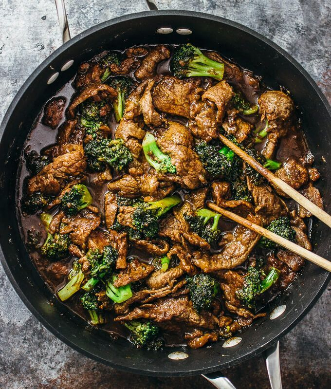 Using chopsticks to easily stir steak and broccoli in a pan