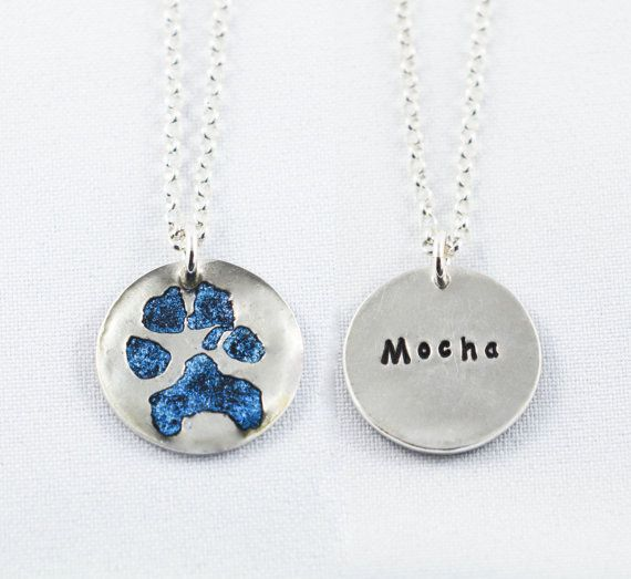 Your pet's paw print on a silver pendant with 6 options of colours!  A must have for those who want to keep a part of their pet close. :)