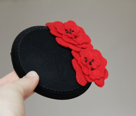 Black coctail hat with beautiful red flowers. The velvet base of the hat is black, lovely felt poppies are bright red. Perfect fall accessory or an