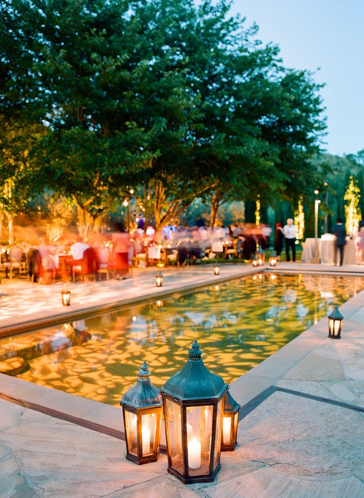 Pool lighting. Style Me Pretty features the natural beauty our Black Swan Lake wedding!  Lighting Design by Got Light.