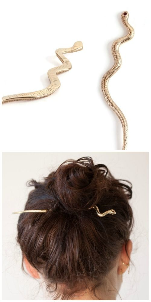 Mokao snake hairpin by Leo Black. In brass, with garnet eyes.