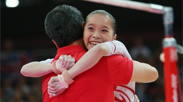 He Kexinof China reacts after competing in the Artistic Gymnastics Women's Uneven Bars final on Day 10 of the London 2012 Olympic Games at North Greenwich Arena