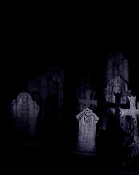 Ghostly images and spirits appear and disappear in the grave yard on a dark scary night