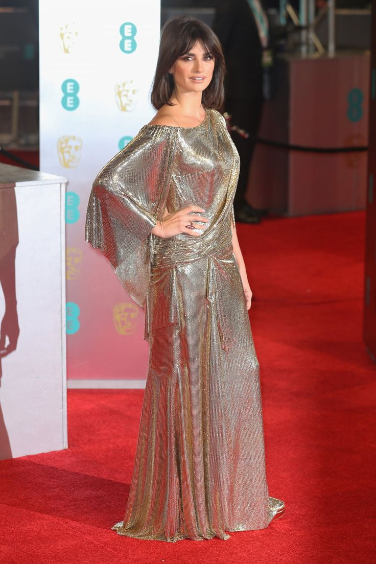 Penelope Cruz shimmered in a golden metallic gown.