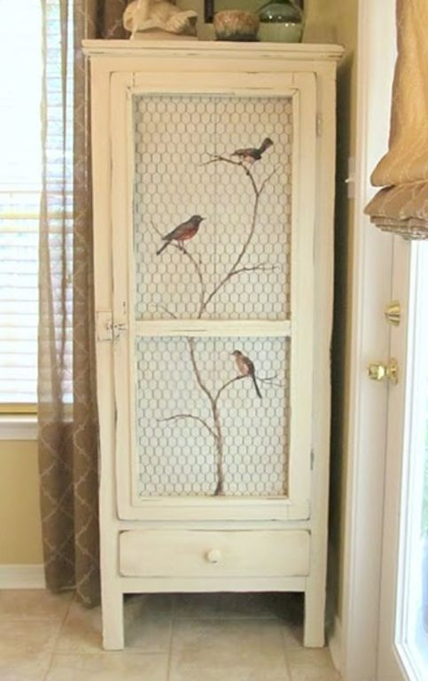 Subtly painted and distressed cabinet with hand painted birds covered by wire mesh for a beautiful display item worthy of an English country house or a French Provincial pile.