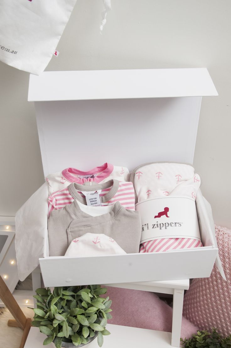 Li'l Zipers: Baby Gift Hamper Pink What's Included: 1 stripe romper 1 anchor romper 1 reversible jacket 1 double sided blanket 2 reversible beanies 1 gift box (per size)