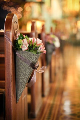 Paisley-printed gray cones, which were filled with pink alstroemerias, added cheer to the church aisle. | www.BridalBook.ph
