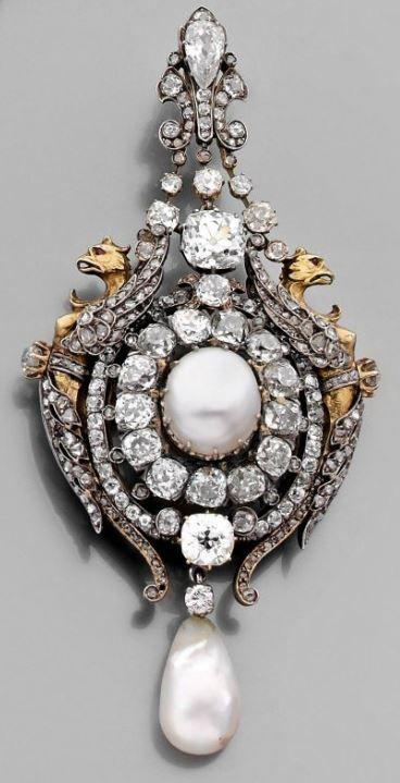 Diamond, gold, silver and pearl jewel.