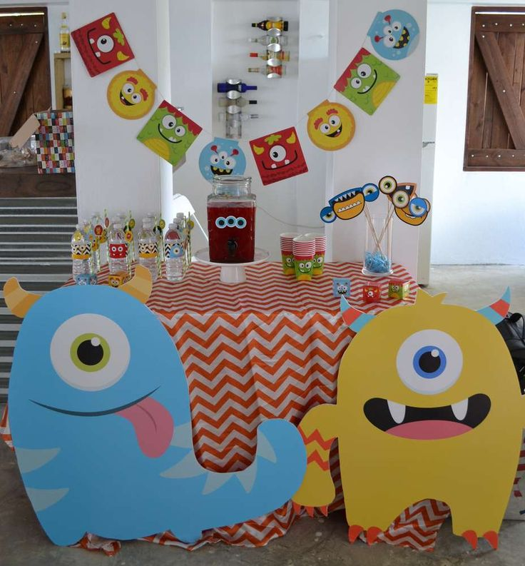 Cool banner and decorations at a monsters birthday party! See more party planning ideas at CatchMyParty.com!