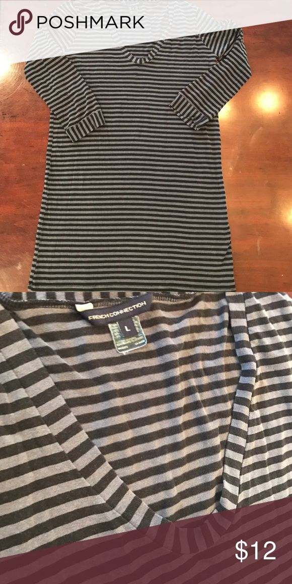 French Connection Tunic Really soft tunic made of cotton and spandex, so it has a little stretch too. Comfy shirt will look great over leggings or jeans. French Connection Tops Tunics