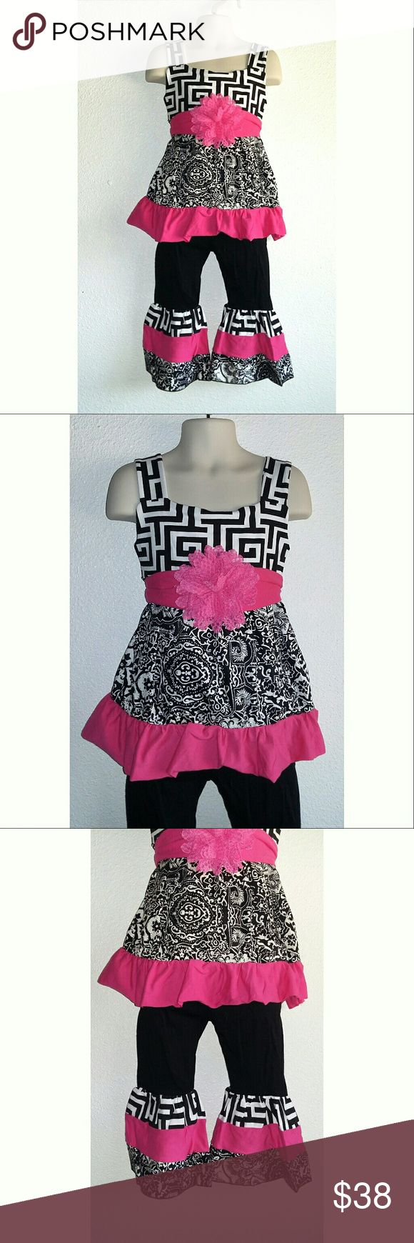🍉OFFER $30🍉Girl By Design Boutique Outfit Be Bold Be Beautiful and Be Comfortable. Comes with top, pants and belt. Top has beautiful bold design with black and white with a pop of pink. Pants are black with elastic waist and beautiful ruffled pattern bottoms.  Boutique Quality and design. 100% cotton  2T: Pants inseam 16in-17, shirt 15in long 3T: Pants inseam 17in-18, shirt 16in long  4T: Pants inseam 18in-19, shirt 17in long 5T: Pants inseam 19in-20, shirt 18in long 6T: Pants inseam…