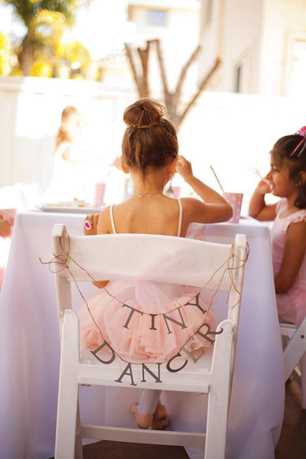 A Ballerina Birthday Party with ballet slipper cake pops & pink tutu cookies, ballet lesson activity, Keep Calm & Dance On sign, tutus for each tiny dancer & more