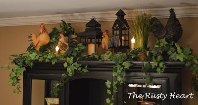 Decorate the top of the hutch in the dining room with Christmas greenery