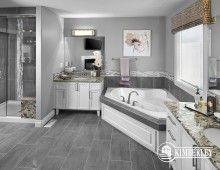 Corner tub, large shower with granite bench, double granite-topped vanities. Ceramic and mosaic tiles. The New Hampshire Model by Kimberley CustomBuilt, built in Edmonton #bathroomdesign #bathroomidea #bathroom #ensuite #interiordesign #homedesign #yegre #customhome #newhome #buildwithkimberley #kimberleyhomes