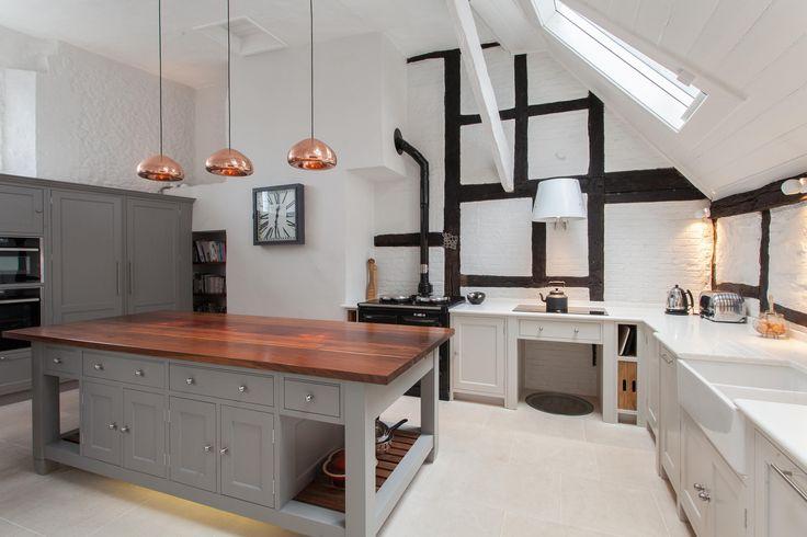 Copper lighting, grey features and open space | Anthony Edwards Kitchens covering Hampshire, Surrey and West Sussex