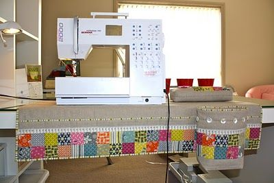 "mat: 30"" x 18""   thread catcher 4 1/2"" W x 7 1/2"" H x 3"" D   pin cushion: 9"" W x 1 1/2"" H x 3"" D Pattern by ""Bloom""."