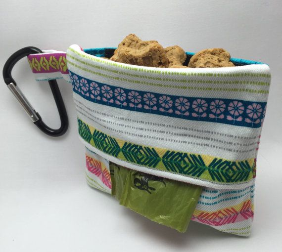 Our original bag now with an added treat pouch! Never be caught without a bag to pick up your dogs waste again or without a treat for a job well done! This fabric poop bag dispenser, holds one roll of plastic dog waste bags and a pouch in the back for treats. This is the perfect leash bag that allows you to always have a plastic roll readily available. Easy to attach to a leash, backpack, purse, or your puppys harness, and ensure your pups treats stay safe with heavy duty velcro. Can also…
