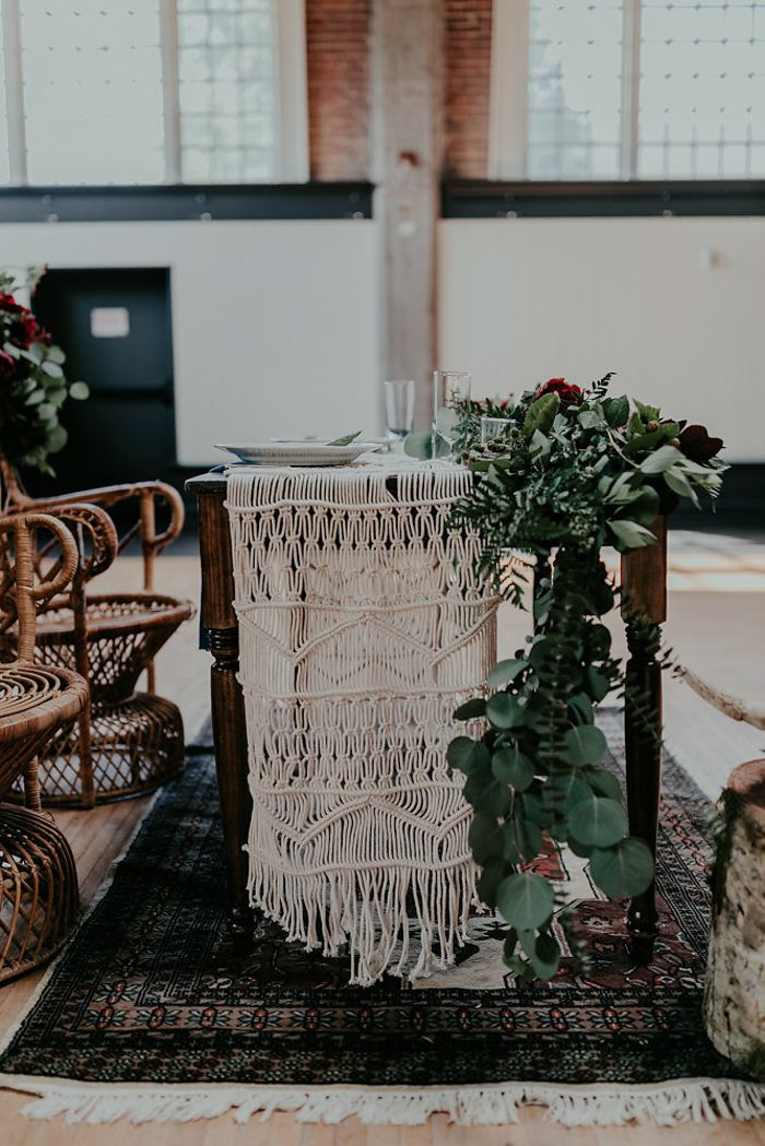 Macrame table cloth and incredible leafy table runner | Image by Olivia Strohm Photography