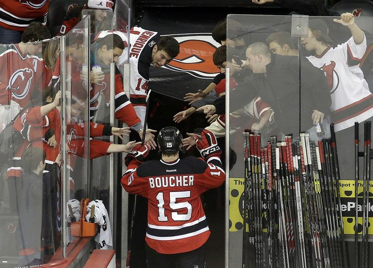 New Jersey Devils left wing Reid Boucher takes a curtain call after an NHL hockey game against the Ottawa Senators, Wednesday, Dec. 18, 2013, in Newark, N.J. Boucher scored his first career NHL goal during the Devils' 5-2 victory. (AP Photo/Julio Cortez)
