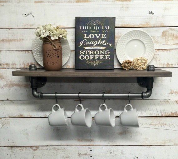 Next time you're at Lowe's grab a cheap hook, and copy this man's gorgeous kitchen storage idea!