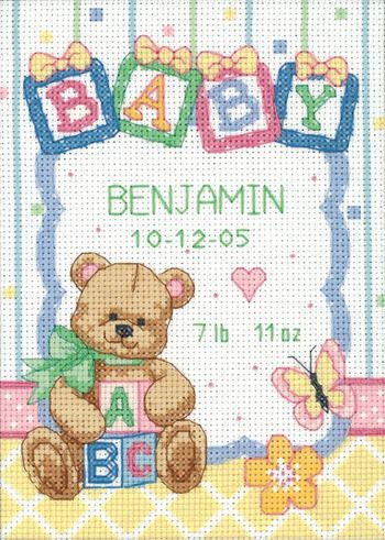 Dimensions Baby Blocks Birth Record Cross Stitch Kit. A cute teddy bear is ready to announce your baby's arrival on this counted cross stitch birth record. This