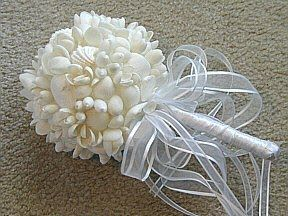 seashell bouquet..... this would be amazing if we weren't getting married in the winter!  I love shells!!!!!!!