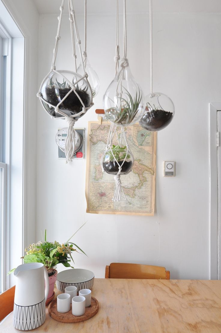 One of the quickest ways to make a kitchen (or any space, really) happier? Add plants! It's true. Real scientific studies have found that plants can make us happier, more productive, and less stressed. And you can still add some greenery if your kitchen is limited in the way of counter or shelf space. Just note these hanging planters in this Montreal kitchen. They totally work over a breakfast table or sink, or just off in the corner. Don't you just want to smile already?