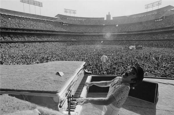Elton John performs at the Dodger Stadium in Los Angeles, October 1975.