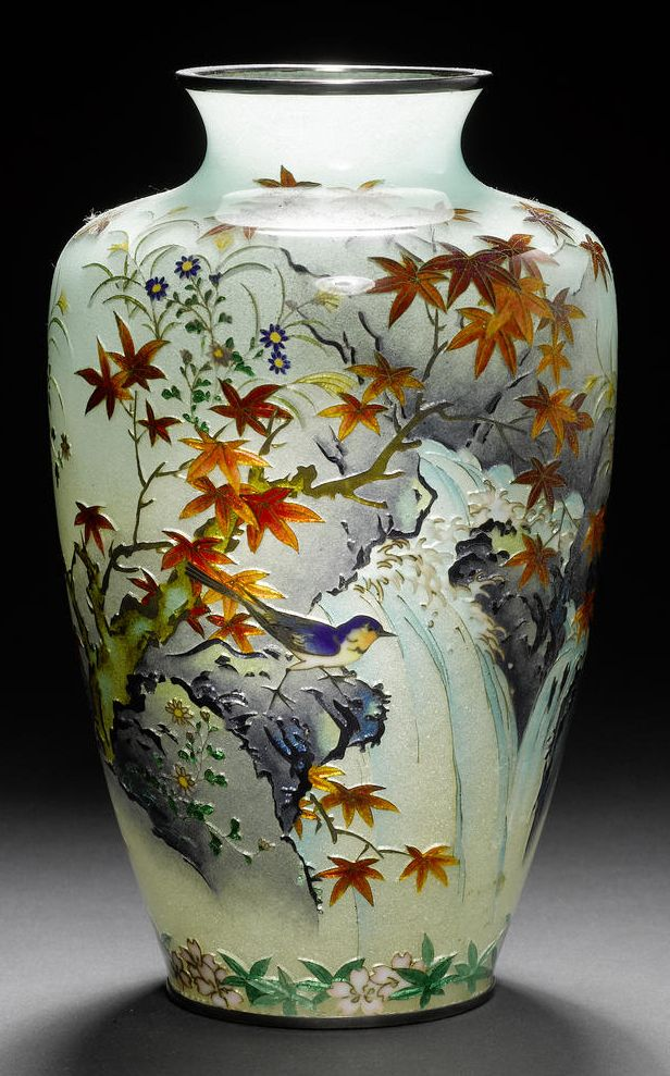 A rare plique-a-jour enamel vase By Kumeno Teitaro of Nagoya (1865-1939), Meiji Period The ovoid body delicately worked in silver wire with blue finches perched on maple branches and sparrows flying above a cascading waterfall, all set on a pale green frosted ground, applied with silver mounts; the base signed with the impressed Kume mark of Kumeno Teitaro. 18½cm (7¼in) high. Bonhams 2009 - £31,200.