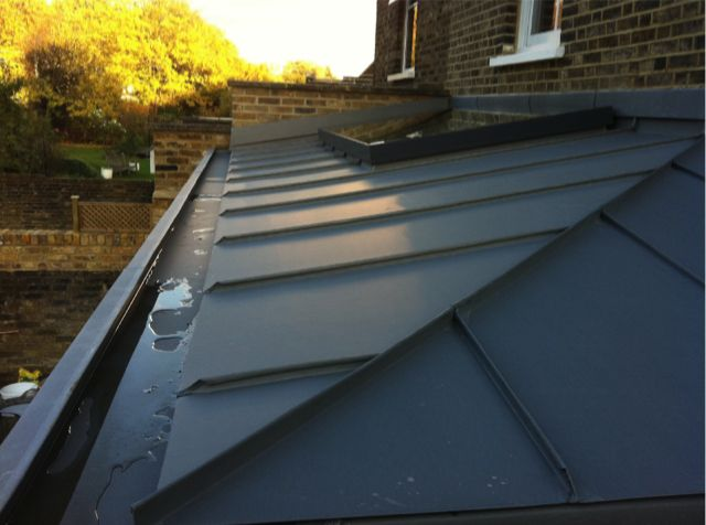 folded hip detail on zinc roof with box gutter, Gospel Oak: topdrawerzinc.co.uk
