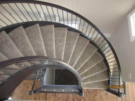 Curved Staircase Railings Built and Installed by Timberwest Railings Ltd. #YYC http://www.timberwestrailings.com/