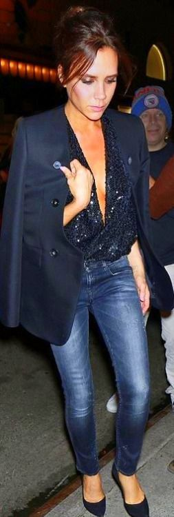 Victoria Beckham reveals a hint of cleavage in a plunging sequin top