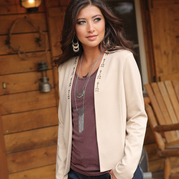 Stylish beige blazer with stud detailing along the front. Its ponte knit design creates a comfortable fit that keeps its shape with extended wear.