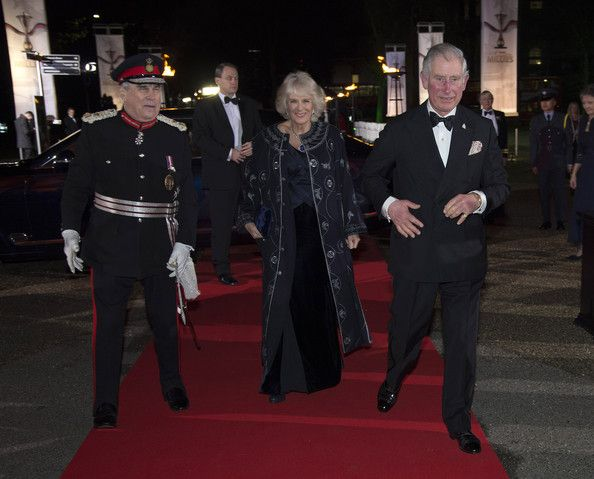 Prince Charles, Prince of Wales and Camilla, Duchess of Cornwall are greeted by Lord-Lieutenant of Greater London Sir David Brewer (L) as they arrive at A Night of Heroes: The Sun Military Awards 2014 at the National Maritime Museum on December 10, 2014 in London, England.