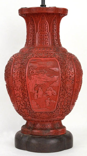 a good Chinese carved cinnabar lacquer vase of quatrefoil baluster form