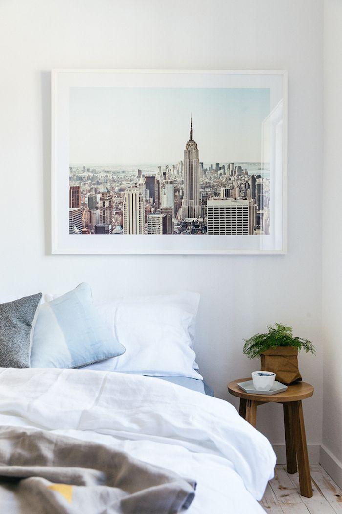 Bedroom: New York skyline photograph framed above bed