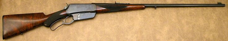 """Winchester 1895 Deluxe First Model Rifle .30 US s/n 65 mfg 1895  - 28"""" round barrel, fancy checkered walnut pistol grip stock w/rubber shotgun buttplate, factory oval silver-plated plate in stock with monogram """"J.A.M.G."""", coin silver rocky mountain front sight, sling swivels. Rifle retains 85% original blue, and most of the original piano finish remain on stocks."""