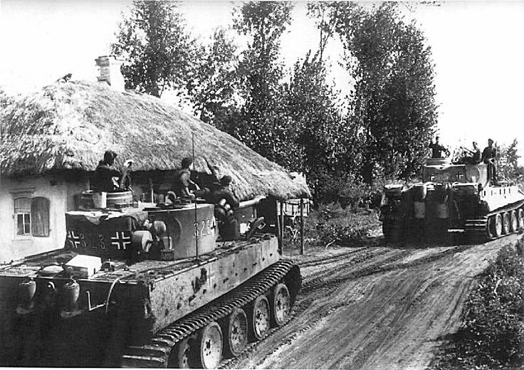 """The battle of Kursk.1943. A column of tanks """"Tiger"""" (Pz. Kpfw. VI Ausf. (E) """"Tiger"""") 3-th company 503 5th heavy tank battalion (Schwere Panzer-Abteilung 503) moves along the village street during the operation """"Citadel"""". The third company of the battalion supported the actions of the 7-th Infantry Division of the Wehrmacht."""
