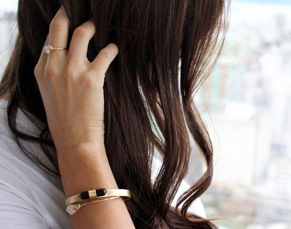 Black Spiral gemstone set on .25 inch brass cuff. Adjustable in size.