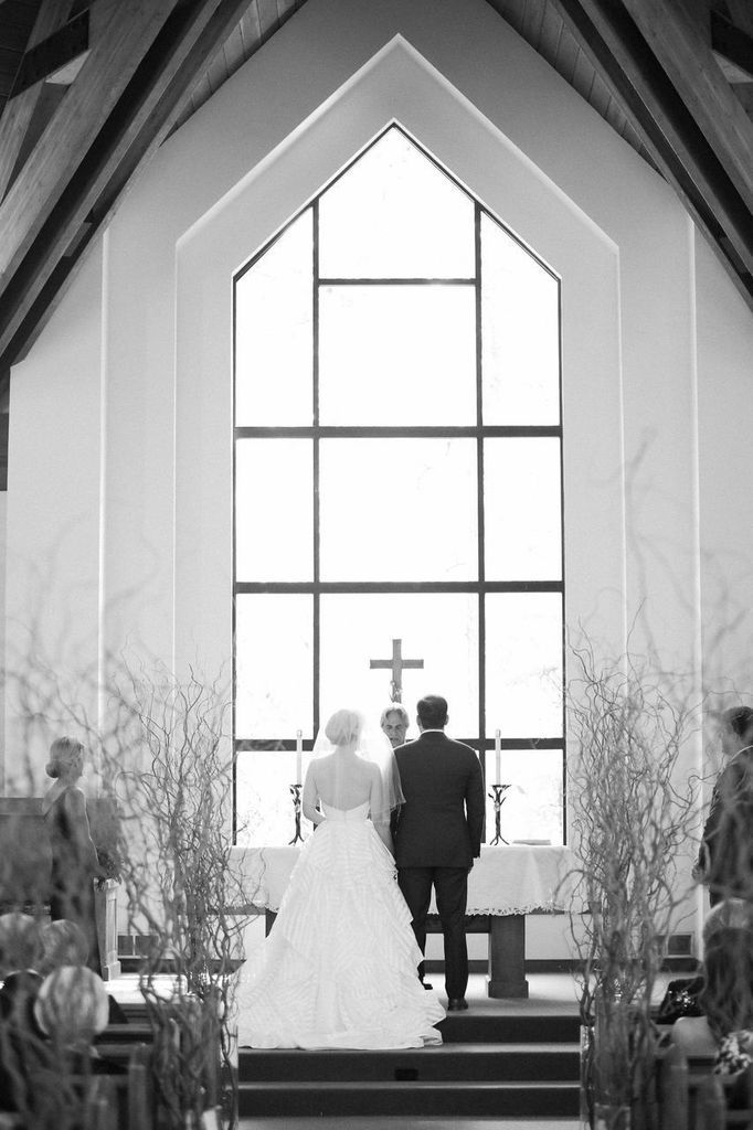 """The couple's ceremony was held at The Chapel at Beaver Creek, overlooking the lush Rocky Mountain balsam tree grove. Lit by natural sunlight and hanging antler chandeliers, the interfaith chapel provided an intimate and rustic ambience. Stacey and Eric opted for nontraditional readings, including Taylor Mali's """"How Falling in Love Is Like Owning a Dog."""""""