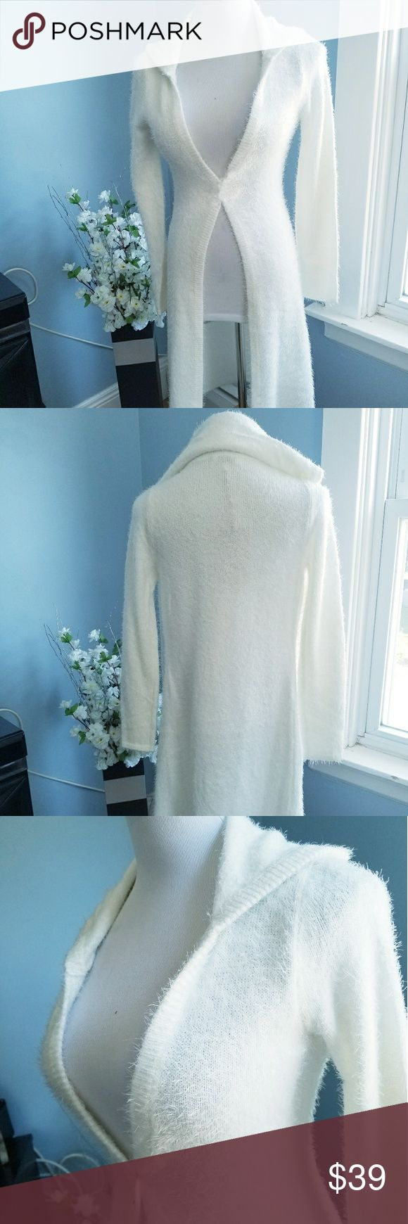 """MARIE Fuzzy White Knit Hooded Open Long Cardigan 60% NYLON 40% ACRYLIC Named after the sassy little kitten from Disney's """"The Aristocats"""" because of how fuzzy and soft this is, this cardigan is perfect for cold and breezy Spring days. Features a super plush fuzzy knit, an open front, a hooded back and a long duster style (length 37"""" on small). Size small to medium *Please note, cardigan is open style. Pinned at waist for photo taking* Bella Edge Sweaters Cardigans"""