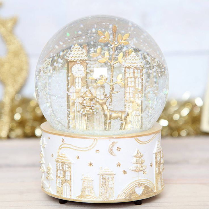 christmas wonderland musical snow globe by red berry apple | notonthehighstreet.com
