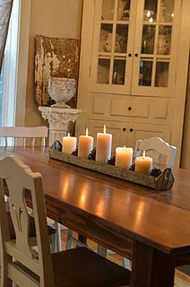 Wood and white with candles as a centre peice
