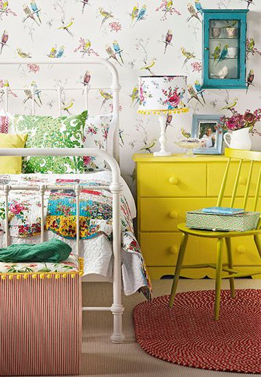 Love the unique pieces in this room, the yellow dresser and vintage bed frame.